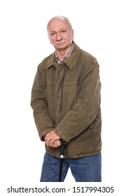 Sad lonely elderly man with a cane standing on a white background