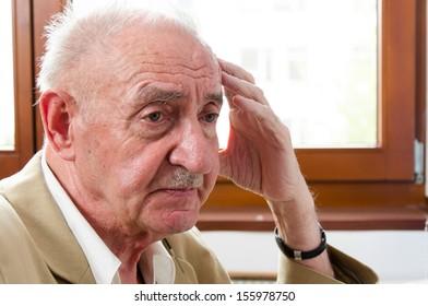 sad lonely old man sitting