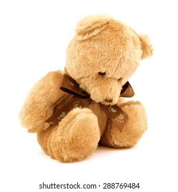 Sad lonely teddy bear isolated on white background like a alone doll, front view.