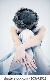 Sad and Lonely ten year old girl in dress looking down.