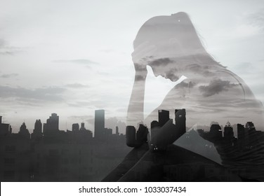 Sad lonely woman in the city. Double exposure.