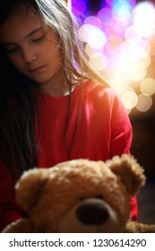 sad and lonely young girl at Christmas