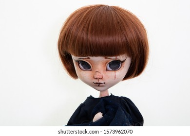 sad makeup doll plastic big eyes