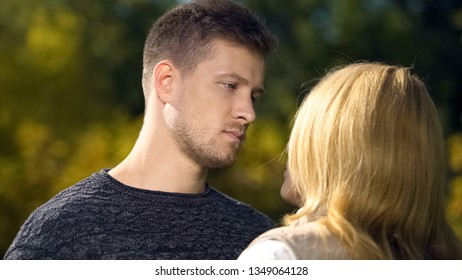 Sad male looking at female, relationship crisis, miscommunication problem