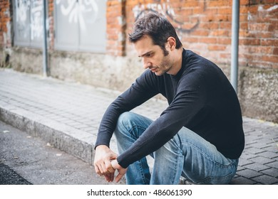 Sad man alone in the city streets