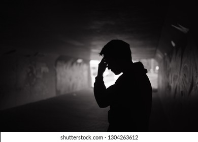Sad man alone on the streets. People in need of help concept.
