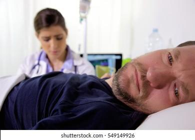Sad man in bed in hospital feeling ill