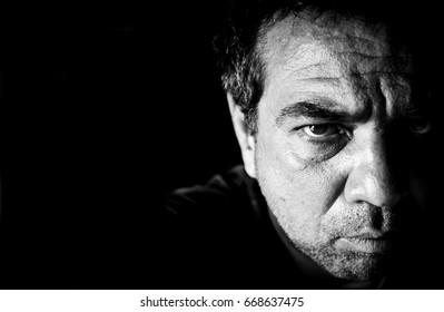 A sad man. Black and white close-up portrait