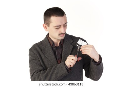 Sad man cutting a credit card