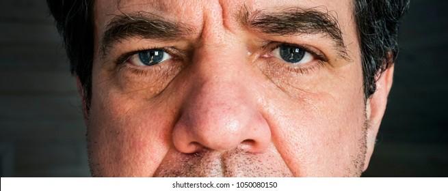 Sad man face. Close-up portrait.