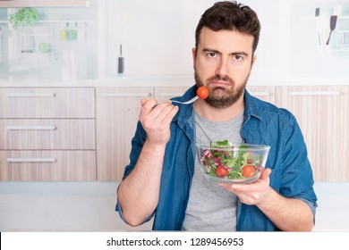 Sad man forced to eat salad for weight loss