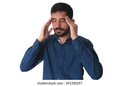 Sad man holding his nose because headache