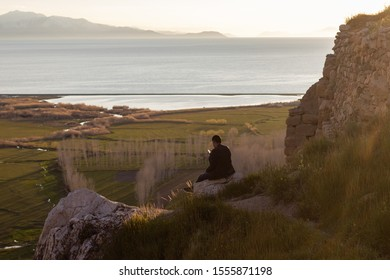 sad man looks at his phone instead of the scenery
