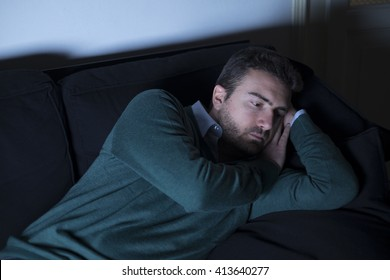 Sad man lying on the couch