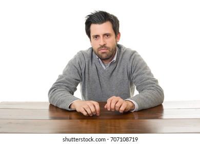 sad man on a desk, isolated