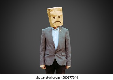 sad man with paper bag on the head