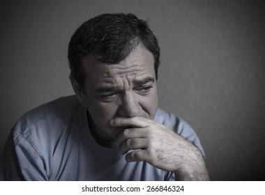 Sad man. Toned photo