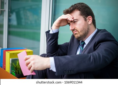 Sad manager after reading downsize notice pink slip