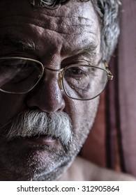 sad middle-aged bearded man