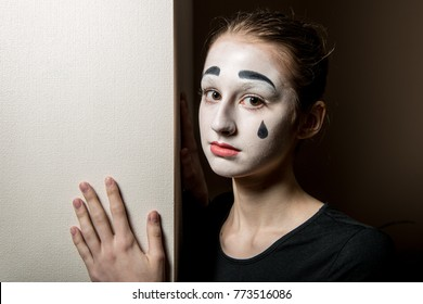 Sad mime. The girl with makeup of the mime.