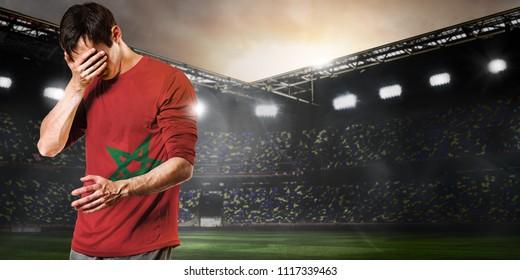 Sad Morocco national team soccer or football player on stadium