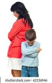 Sad mother and son standing with hands crossed and looking down after conflict isolated on white background
