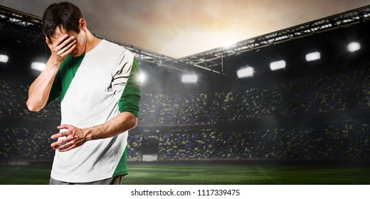 Sad Nigeria national team soccer or football player on stadium