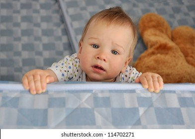 Sad nine month old baby looks at you