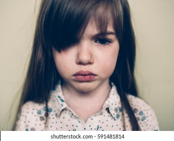 sad offended little girl cries