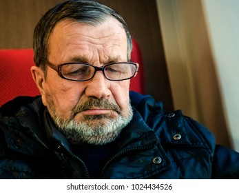 Sad old bearded man with glasses close-up portrait