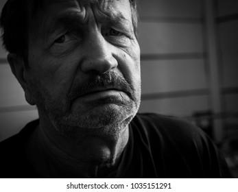 Sad pensive bearded man close-up portrait