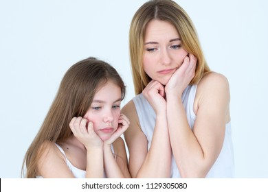sad pensive lonely pair of mother and daughter. waiting missing someone. family life downfalls and unpleasant situations