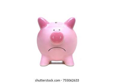 Sad pink piggy bank closeup isolated