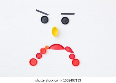 sad plastic waste, anthropomorphic face