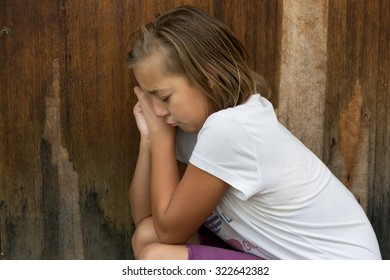 Sad poor child weeping because has no friends