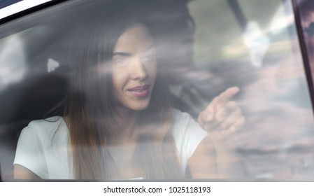 sad portrait of a woman outside a car window