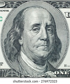 Sad President Benjamin Franklin portrait on 100 US dollar bill