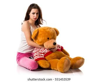 Sad  pretty brunette girl with pajamas