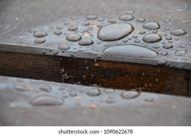 Sad Raidrops on a wood table