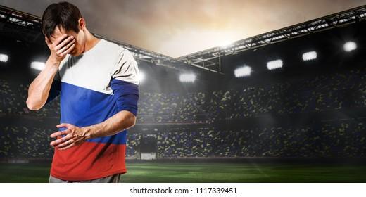 Sad Russia national team soccer or football player on stadium