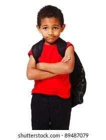 Sad schoolboy with his arms crossed