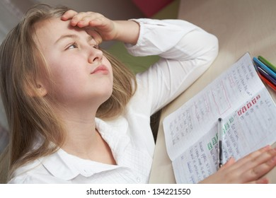 Sad schoolgirl have stress while studying