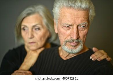 Sad Senior couple