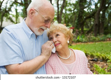 Sad senior couple in grieving the loss of a loved one.