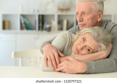 Sad Senior couple at home