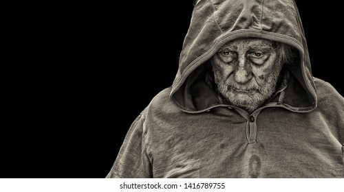 A sad Senior Homeless man on Black