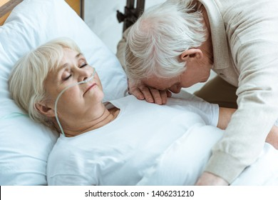 sad senior man and senior woman in coma in hospital