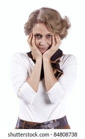 sad senior woman with her hans on her face (isolated on white)