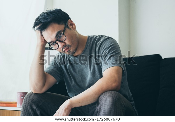 sad serious man.depressed emotion panic attacks alone young people fear stressful.crying begging help.stop abusing domestic violence,person with health anxiety, bad frustrated exhausted feeling down