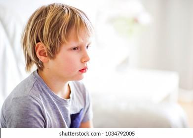sad sick child gray clothes
